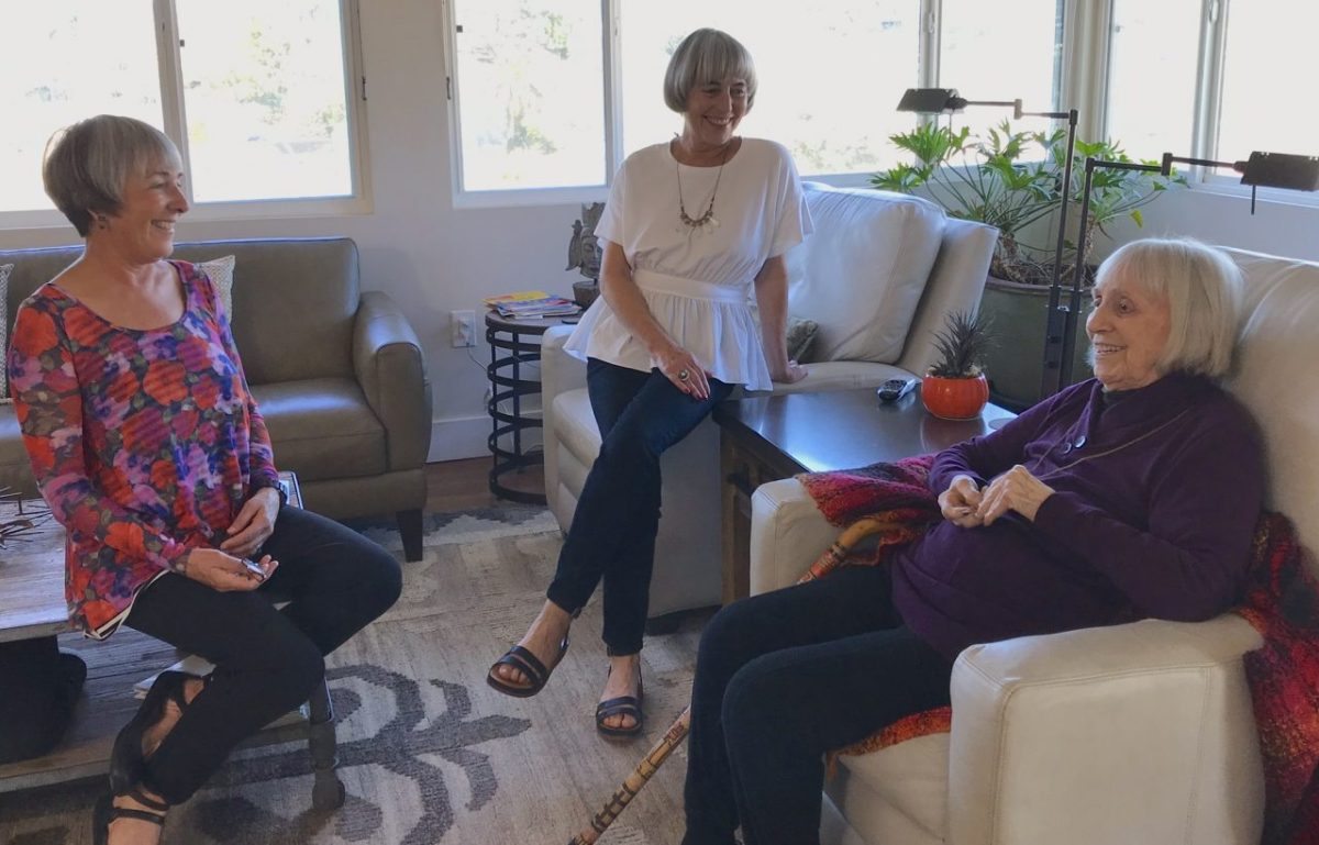 Ginny Davenport,100, of San Diego enjoys a chat with her daughters Kelly Davenport (center) and Riley Davenport (left). The daughters are part of a growing trend of older adults caring for their elderly parents. Photo by Amita Sharma, KPBS