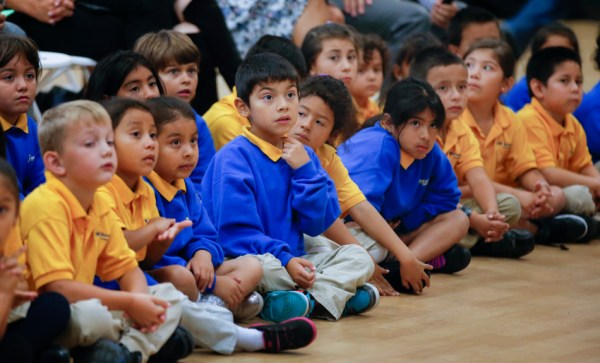 Students listen as guest speaker Sheryl Sandberg, COO of Facebook, speaks during the opening ceremony for the new KIPP Excelencia Community Prep, a public charter school, in Redwood City, Calif., on Thursday, Sept. 17, 2015. (John Green/Bay Area News Group)