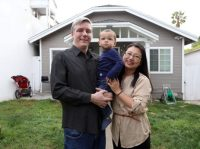 Jason Jarvis his wife Jun Cao and their 15 month old son Kellar Jarvis have breakfast at their home on Wednesday morning in Inglewood, California. Assignment for Tax Day story about how California families were impacted in the first year of federal tax changes. The Jarvis' say they were unable to deduct as much of their local property taxes and ended up paying about $2,000 more despite increases in other deductions, such as child care expenses. Photos by Iris Schneider on April 3, 2019