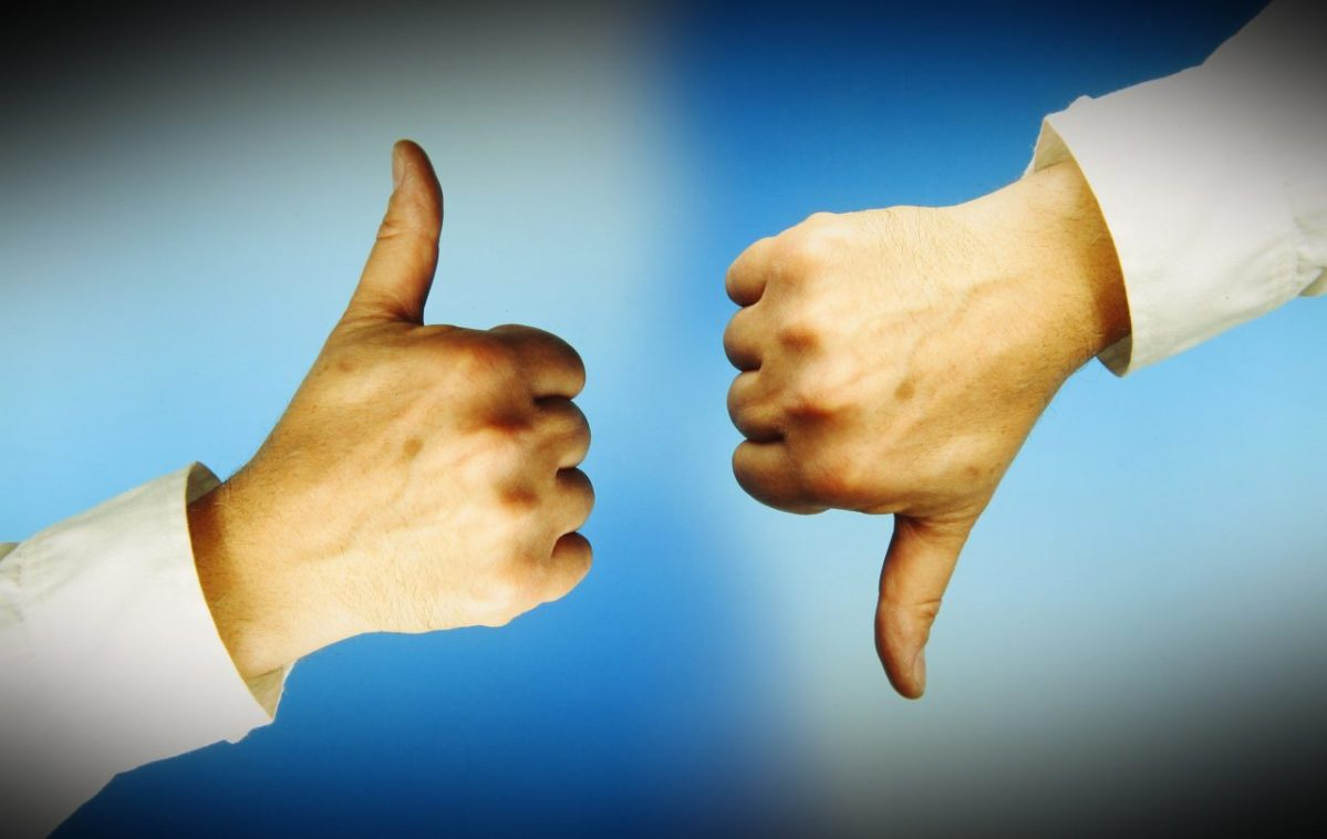 One hand with thumbs up, another with thumbs down. Blue background.