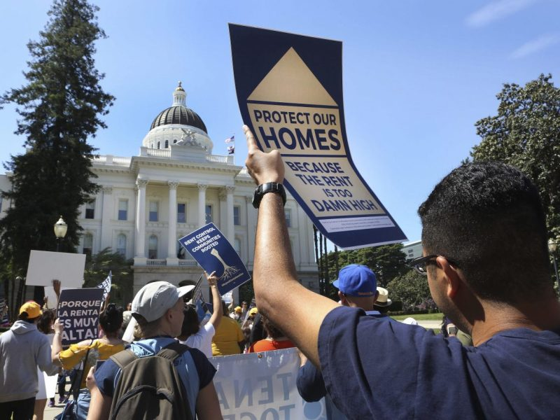 Marchers walk to the California Capitol last spring to protest the high cost of rental housing in the state. Photo by Steve Yeater/AP Images