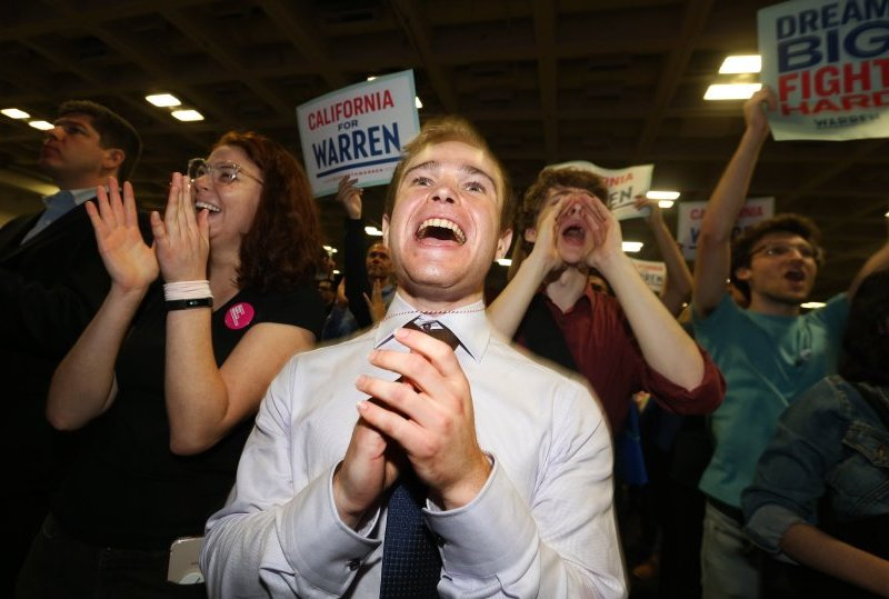 Blake Kazarian and other delegates cheer presidential candidate Sen. Elizabeth Warren as she addresses the California Democratic Party Convention at the Moscone Convention Center in San Francisco. Photo by Ray Chavez/Bay Area News Group
