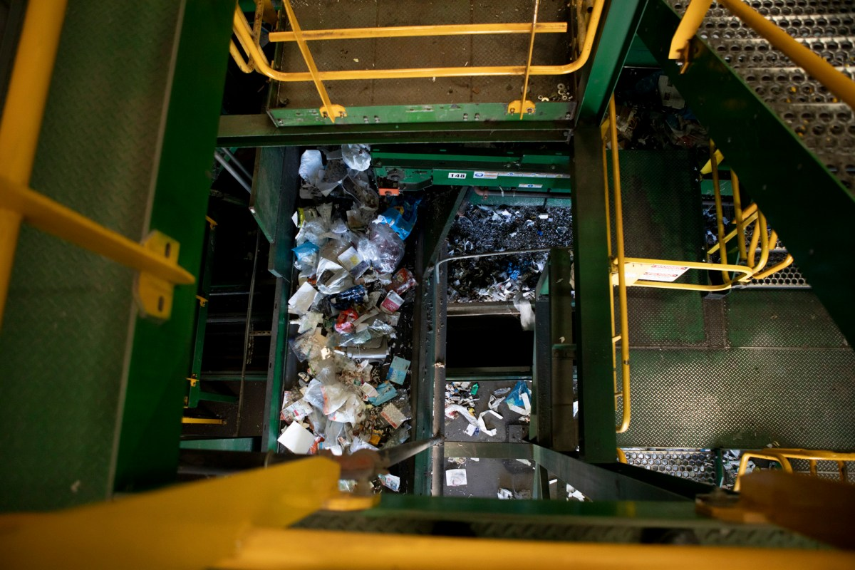 Two levels of conveyer belts carrying items to be recycled seen from above at greenwaste in San Jose on July 29, ,2019. Photo by Anne Wernikoff/CalMatters
