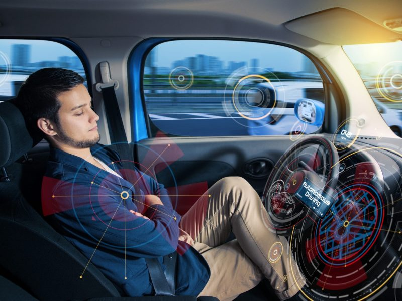 Sleeping driver in autonomous car. Photo by metamorworks, istockphoto.com
