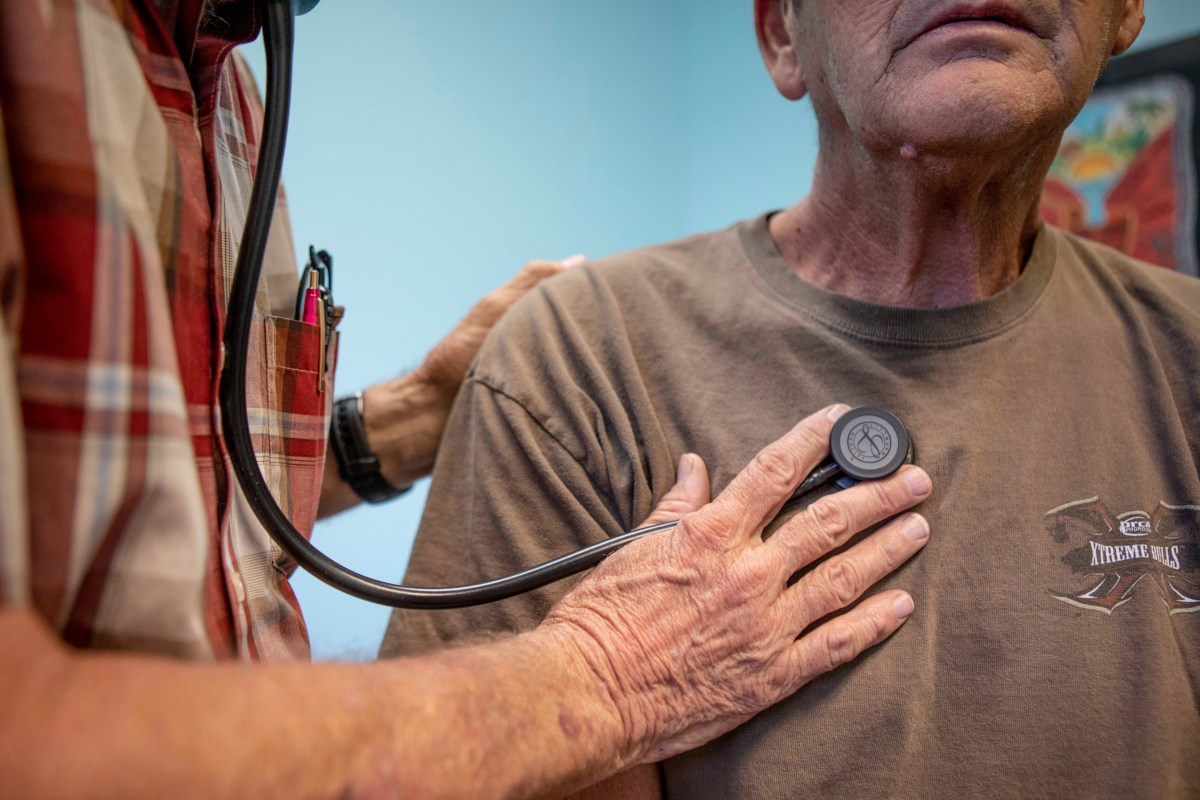 A doctor listens to a man's breathing at a clinic in Bieber, California on July 23, 2019. Photo by Anne Wernikoff for CalMatters