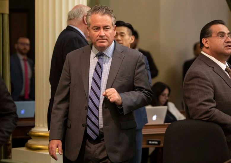 Assemblymember Patrick O'Donnell walks across the floor on September 10, 2019. Photo by Anne Wernikoff for CalMatters