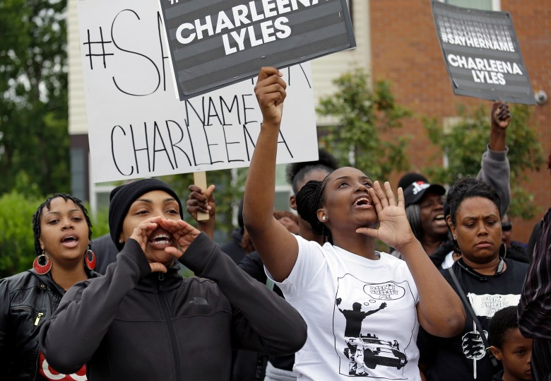 Relatives and friends of a pregnant mother who was shot and killed by police chant at a gathering near the place she was killed, Tuesday, June 20, 2017, in Seattle. Police officers shot and killed 30-year-old Charleena Lyles on Sunday after authorities said Lyles confronted the officers with a knife.