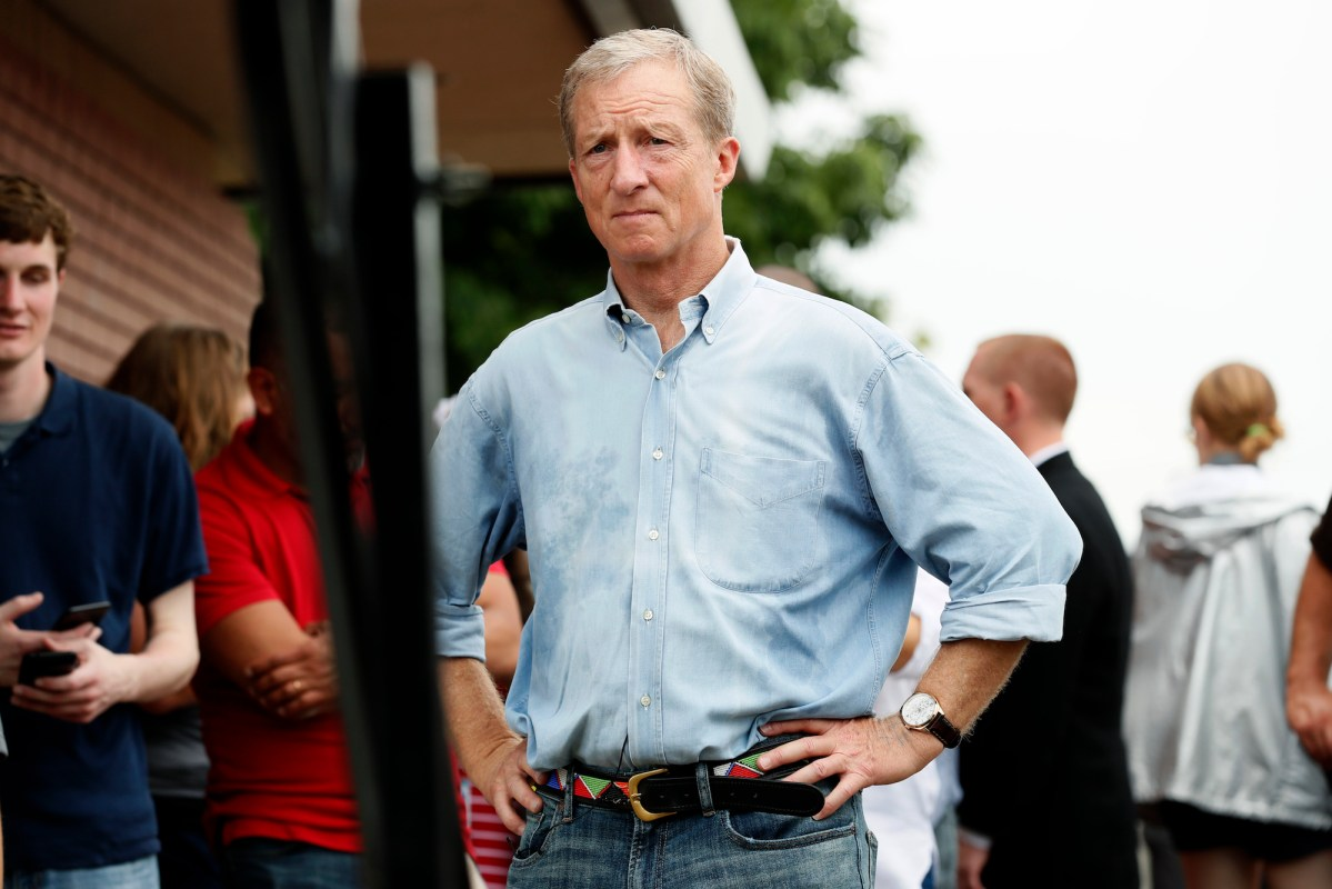 Democratic presidential candidate and businessman Tom Steyer waits to speak at the Des Moines Register Soapbox during a visit to the Iowa State Fair. AP Photo/Charlie Neibergall