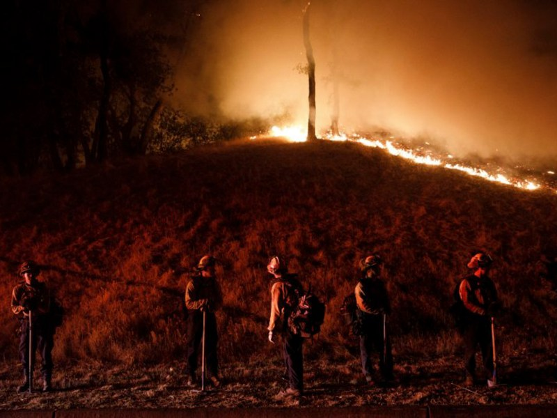 Firefighters stand watch by a fire line along Mayacama Club Drive as the Kincade Fire burns in the outskirts of Santa Rosa on Oct. 28, 2019. Photo by Dai Sugano, Bay Area News Group