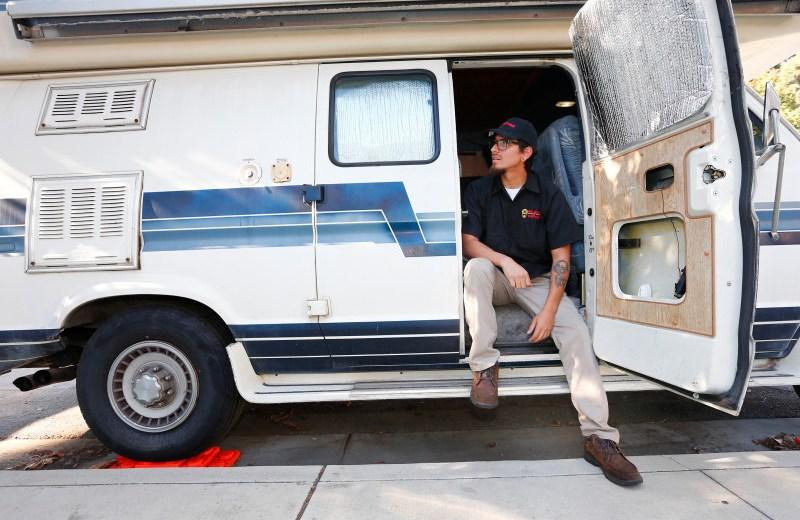 Derek Duarte, 26, sits outside of his small motorhome near downtown Mountain View, California, on Tuesday, Nov. 7, 2017. Duarte lives here with his girlfriend to save money while he pursues an Automotive Technology degree at De Anza College in Cupertino. Duarte has been a beneficiary of the Food Pantry at the school which has helped him lower his food costs. Photo by Gary Reyes/ Bay Area News Group