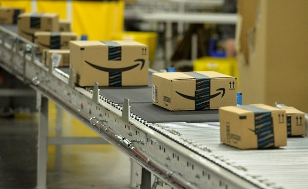 Packages travel down a conveyor belt before being scanned and a shipping address is attached at the Amazon fulfillment center in Tracy, Calif., on Tuesday, April 12, 2016. (Doug Duran/Bay Area News Group)