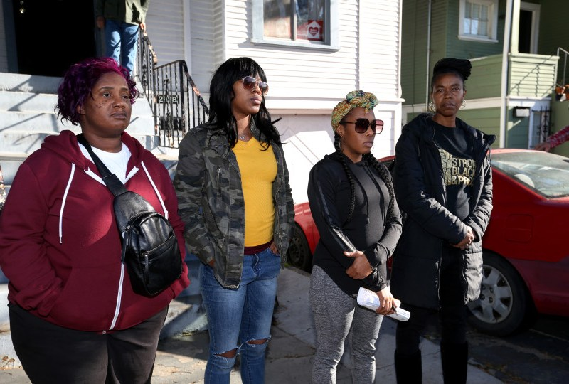 Moms 4 Housing members Sharena Thomas, left, Misty Cross, Dominique Walker and Tolani King look on during a press conference outside the house they have occupied on Magnolia Street in Oakland on Friday, Jan. 10, 2020. Photo by Ray Chavez, Bay Area News Group