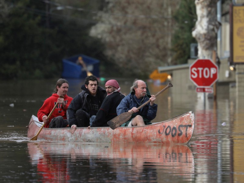 Guerneville residents paddle through the flooded streets of their Russian River town, Tuesday, Feb. 27, 2019