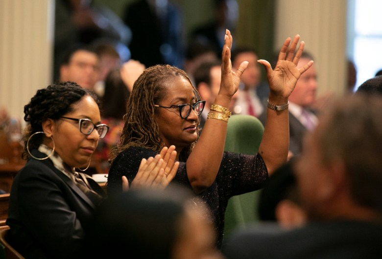 Sen. Holly Mitchell reacts to Gov. Gavin Newsom's call for a response to the housing crisis and displacement of communities through gentrification during the 2020 State of the State address. Photo by Anne Wernikoff for CalMatters