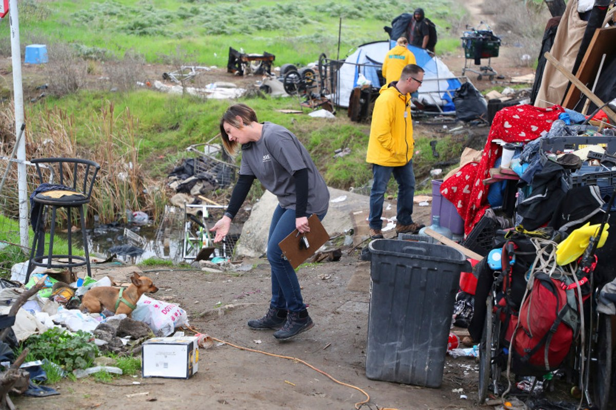 CORE outreach member Dori Geer, left, walks through a homeless camp with team members during a count of homeless people by Contra Costa Health Services on Wednesday, Jan. 30, 2019, in Bay Point, Calif.