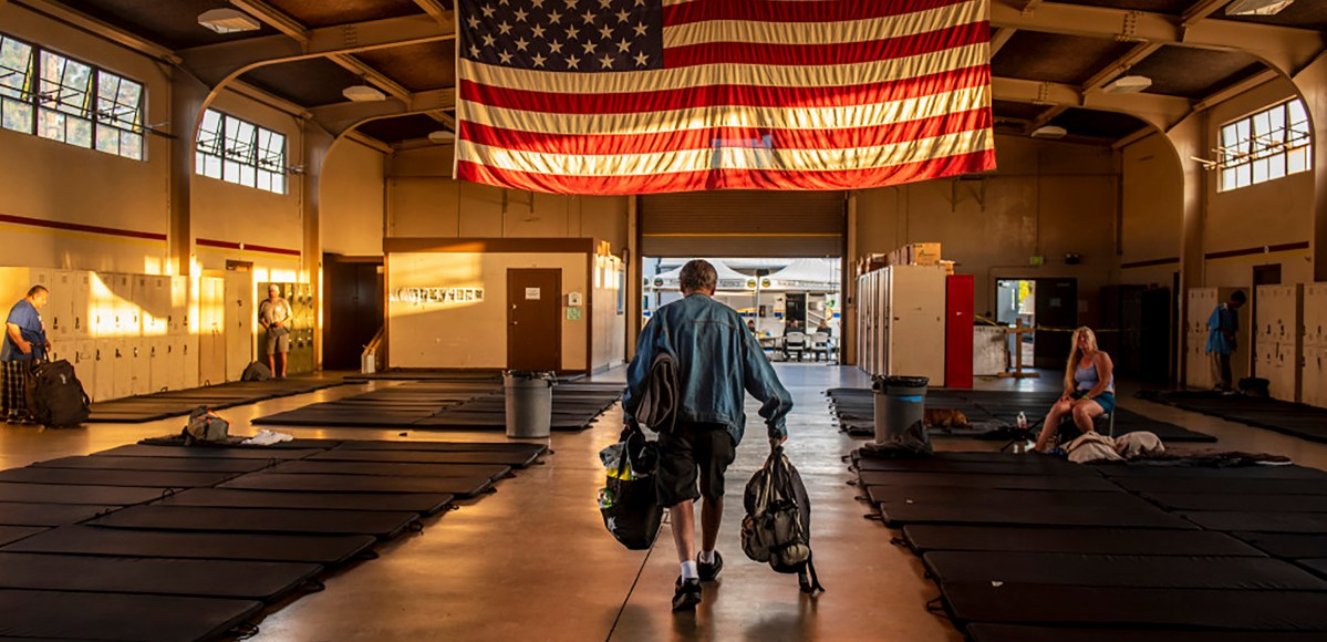 Homeless begin to enter the California National Guard Armory in Santa Ana on Thursday, July 12, 2018.