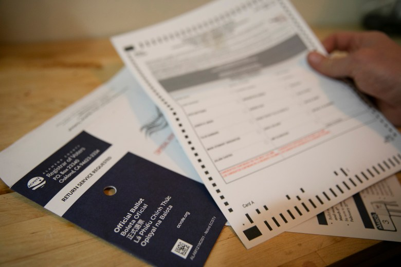 Three-quarters of ballots mailed to Californians had yet to be returned as of the day before Election Day. Photo illustration by Anne Wernikoff for CalMatters