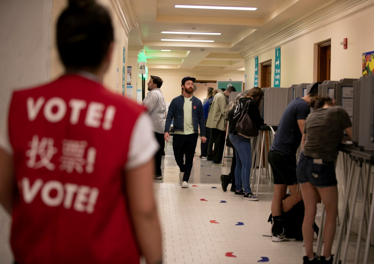Voters fill out their ballots at San Francisco City Hall on California primary night 2020. Photo by Anne Wernikoff for CalMatters