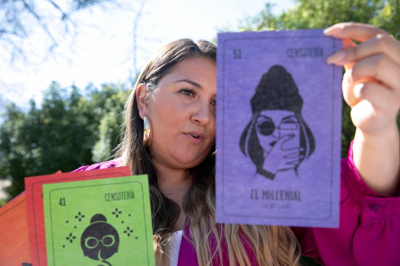 Angie Sanchez, community engagement manager at La Luz Center in Sonoma, pulls out the 'El Millennial' card from the Censoteria deck. Photo by Anne Wernikoff for CalMatters