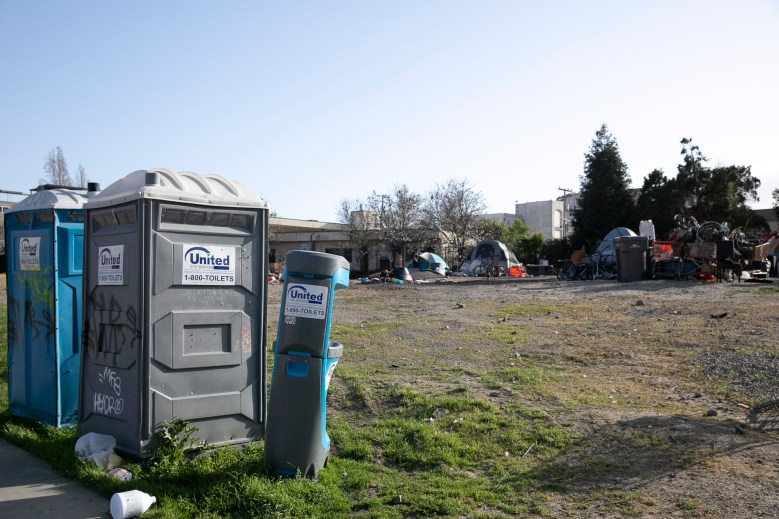 A hand sanitizing station at a homeless encampment near Oakland city hall. Photo by Anne Wernikoff for CalMatters
