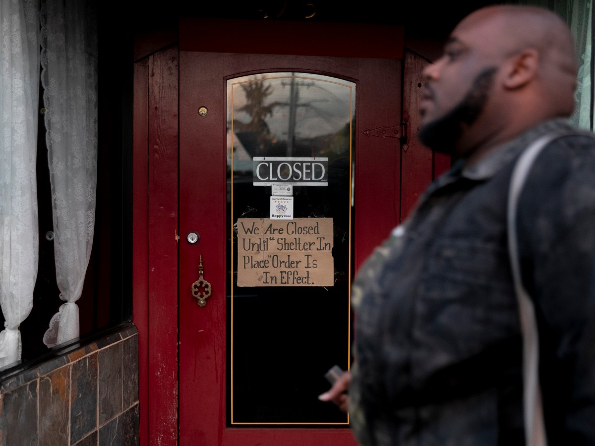 A sign attached to a restaurant door in the Temescal neighborhood of Oakland alerts customers that it will remain closed during the 'shelter in place' mandated for six Bay Area counties on March 16, 2020.