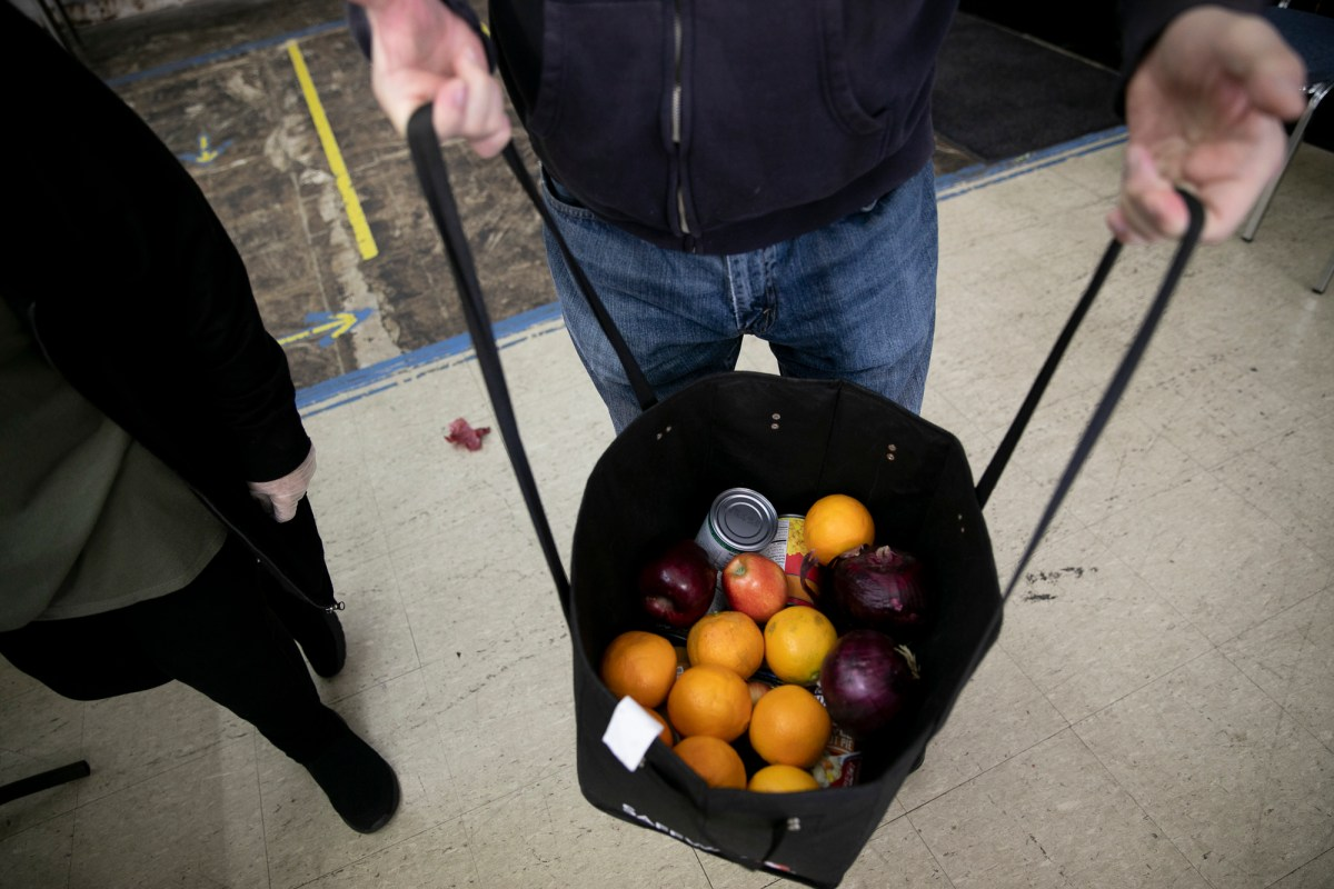 A shopping bag full of fruit and canned goods at the Contra Costa & Solano County Food Bank distribution site at Teamsters 315 Hall in Martinez. Photo by Anne Wernikoff for CalMatters