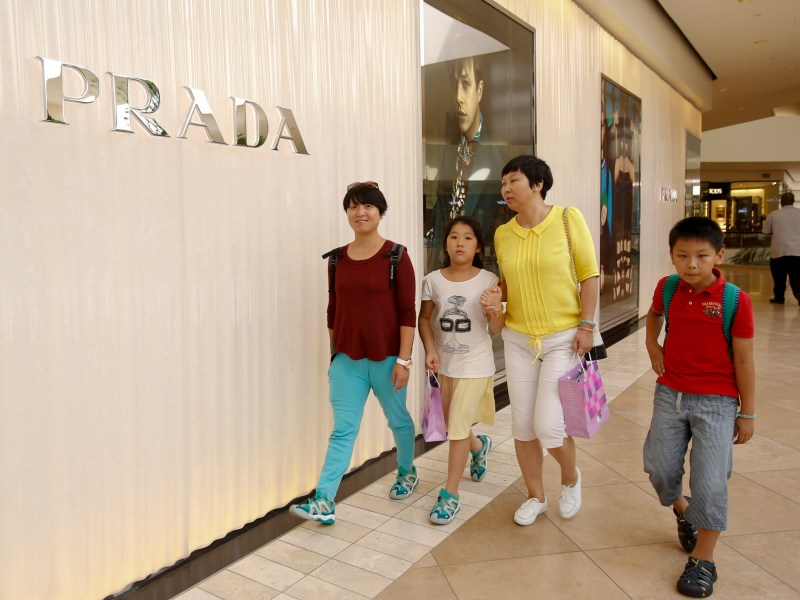 In this July 18, 2014 photo, Chinese tourists visit the South Coast Plaza Shopping Center in Costa Mesa, Calif. Photo by Damian Dovarganes, AP Photo