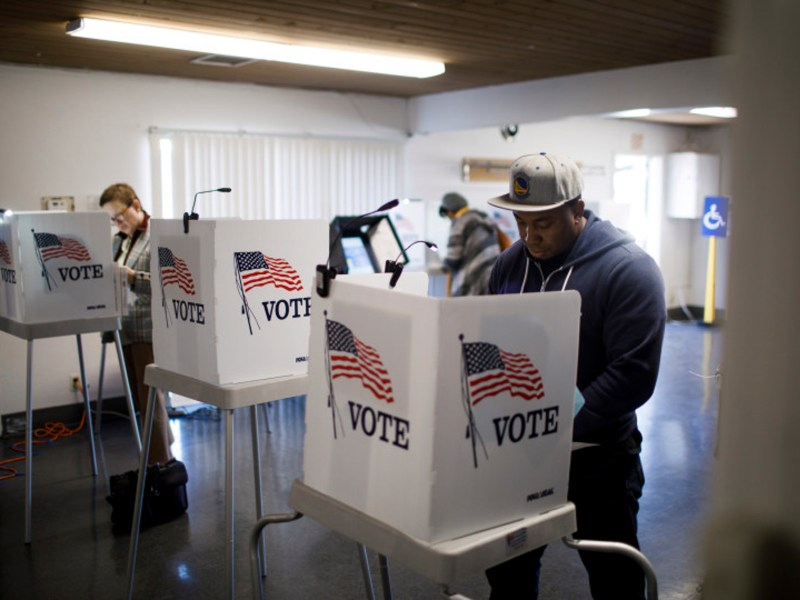 Voters including Dave Ade of San Jose, right, fill out their ballots on Nov. 6, 2018, at The Salvation Army in San Jose. Photo by Dai Sugano, Bay Area News Group