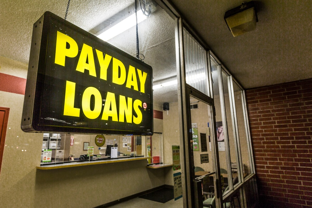 Money Mart payday loans and check cashing store in Sacramento, California. Photo via Creative Commons