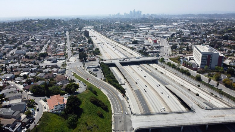 General overall aerial view of sparse traffic on the Interstate 10 freeway amid the global coronavirus COVID-19 pandemic, Wednesday, April 1, 2020, in Los Angeles. Photo by Kirby Lee via AP
