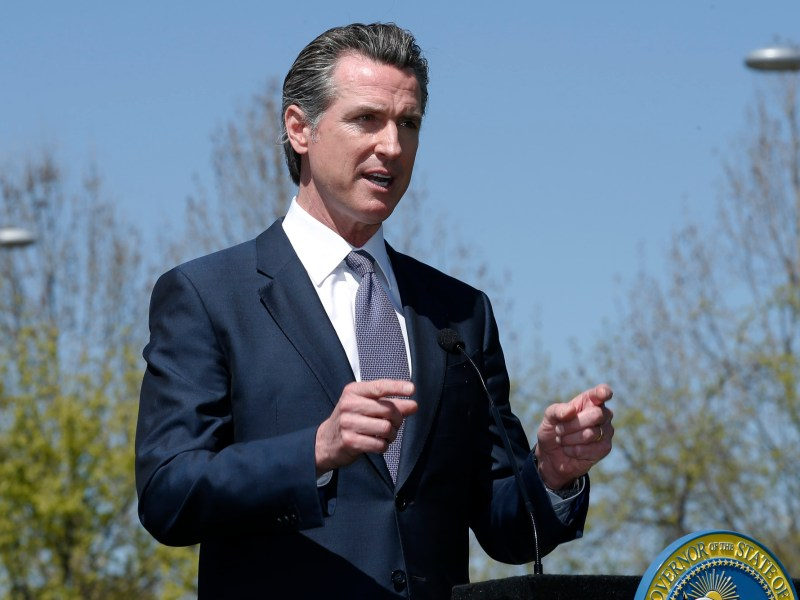 Gov. Gavin Newsom discuses California's efforts to convert hotels and motels into isolation housing for the homeless threatened by the coronavirus during a news conference near Sacramento, Calif. April 3, 2020.
