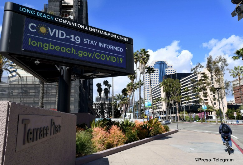 The sign in front of the Terrace Plaza instructs citizens where to get updated information on the coronavirus in Long Beach on Thursday, March19, 2020. Photo by Brittany Murray, Press-Telegram/SCNG