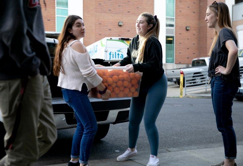Students deliver a produce donation to the basic needs center at Chico State University on February 12, 2020. Photo by Anne Wernikoff for CalMatters