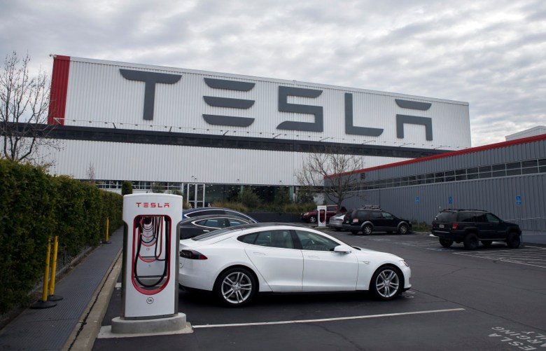 File photos of Teslas lined up in the Tesla Motors complex in Fremont on Thursday, January 28, 2016.  Photo by LiPo Ching / Bay Area News Group