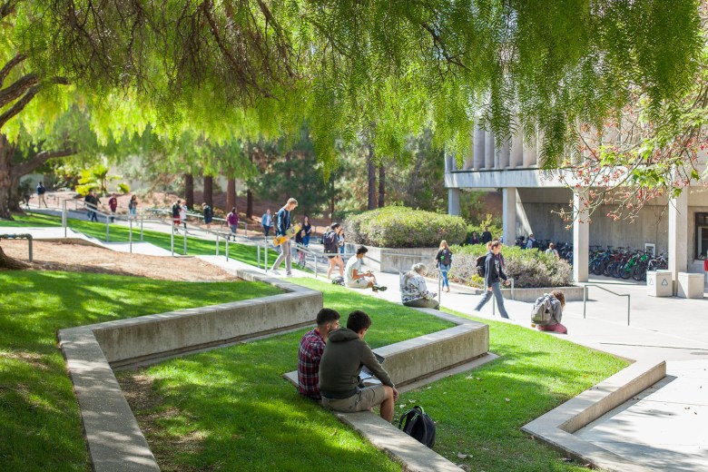 Students sit on the terraced lawn outside of Kennedy Library at Cal Poly San Luis Obispo on September 24, 2018. Photo by Hannah Travis via Flickr