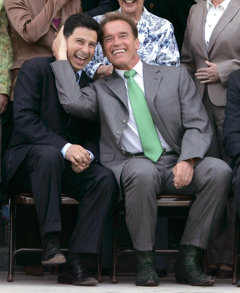 Gov. Arnold Schwarzenegger, right, and Assembly Speaker Fabian Nunez joke around before a legislative group photo is taken at the Capitol in Sacramento on June 13, 2007. Photo by Rich Pedroncelli, AP Photo
