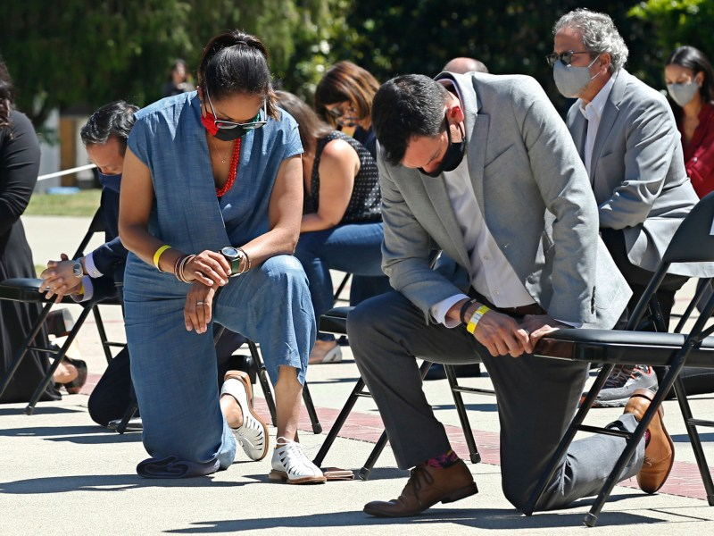 Assemblywoman Sydney Kamlager, left, and Assembly Speaker Anthony Rendon, right, join other members of the California Legislature as they kneel for 8 minutes and 46 second to honor George Floyd at the Capitol on June 9, 2020. Photo by Rich Pedroncelli, AP/Pool