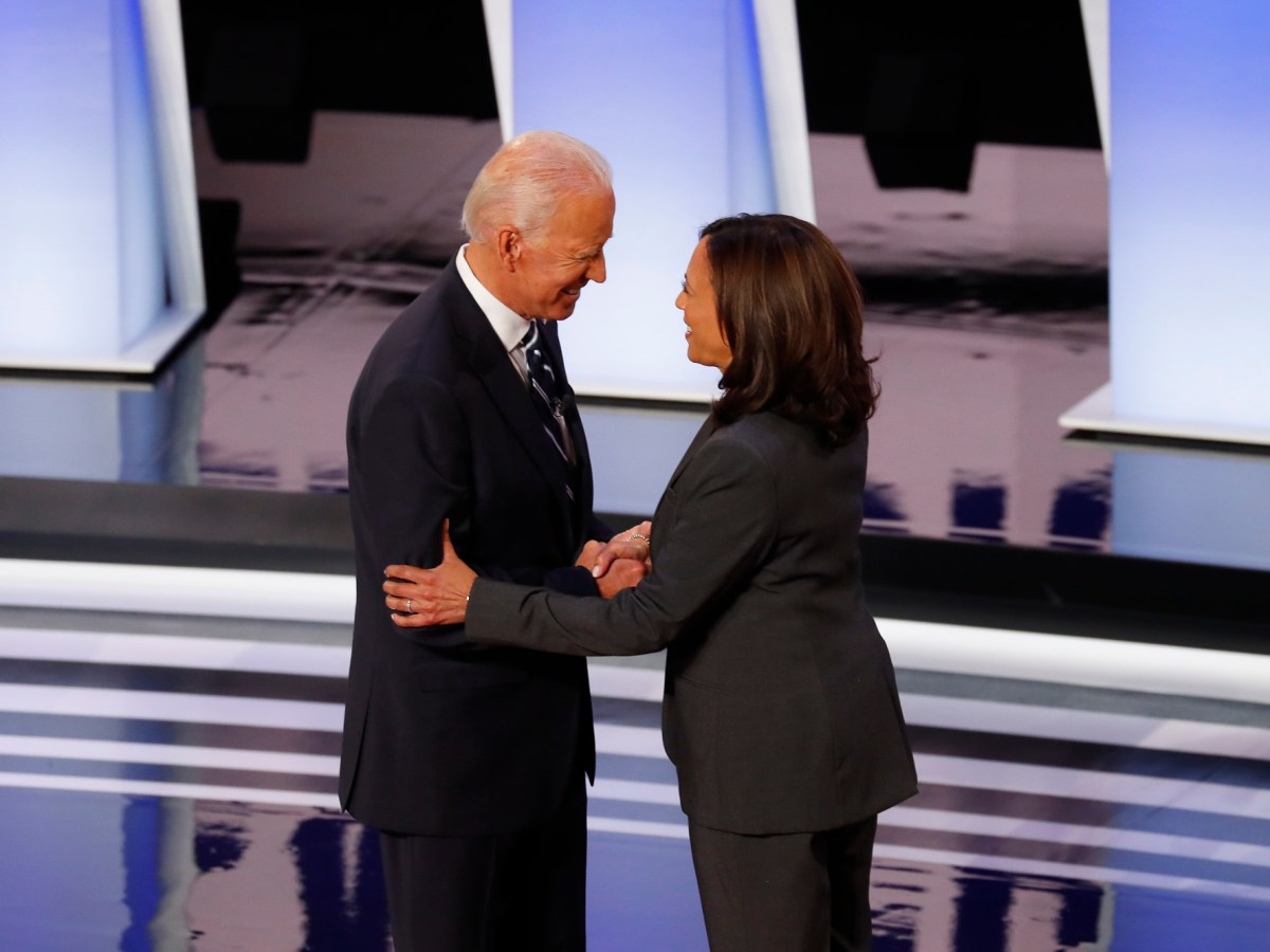 Former Vice President Joe Biden shakes hands with Sen. Kamala Harris before the second of two Democratic presidential primary debates hosted by CNN, July 31, 2019 in Detroit. Photo by Paul Sancya, AP Photo