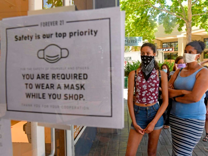 Frederique Van Niekerk, from left, and her mother Bernadette Van Niekerk wear masks while waiting in line to enter the clothing store Forever 21 while shopping in Walnut Creek on June 18, 2020. Photo by Jose Carlos Fajardo, Bay Area News Group