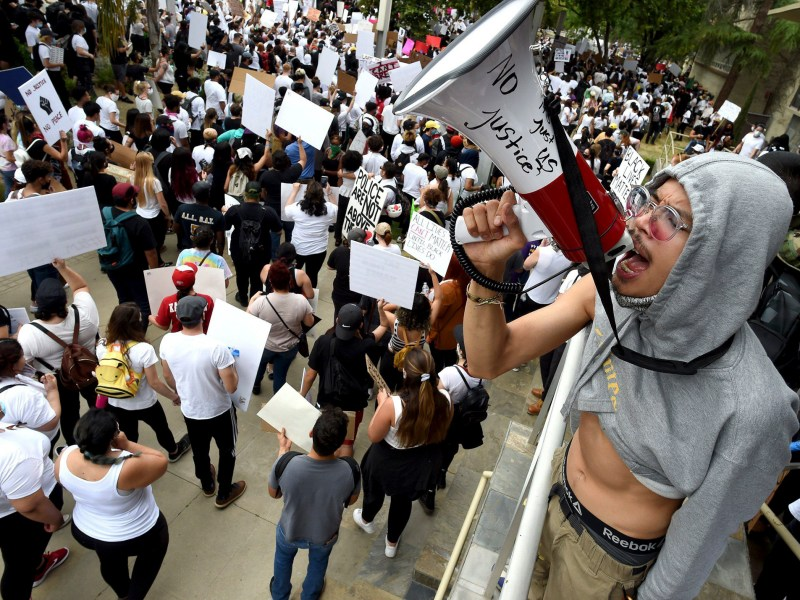 Eddie Wutangsy uses a bullhorn while chanting to the crowd of several thousand protesters as they march past Fresno Police headquarters during a protest over the death of George Floyd by Minneapolis police, May 31, 2020. Photo by John Walker, The Fresno Bee