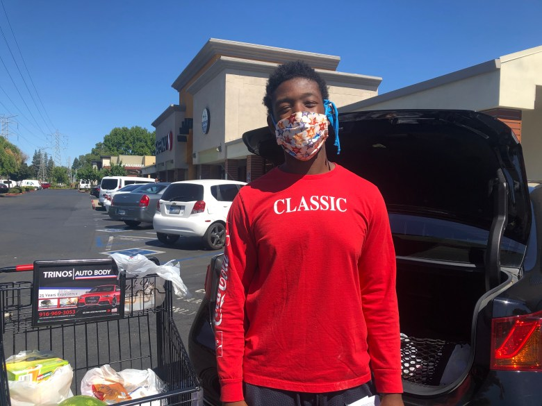 Sinah Yovonie, 27, of Sacramento wears a mask while grocery shopping, but doesn't think face coverings should be mandated. Photo by Ana B. Ibarra for CalMatters