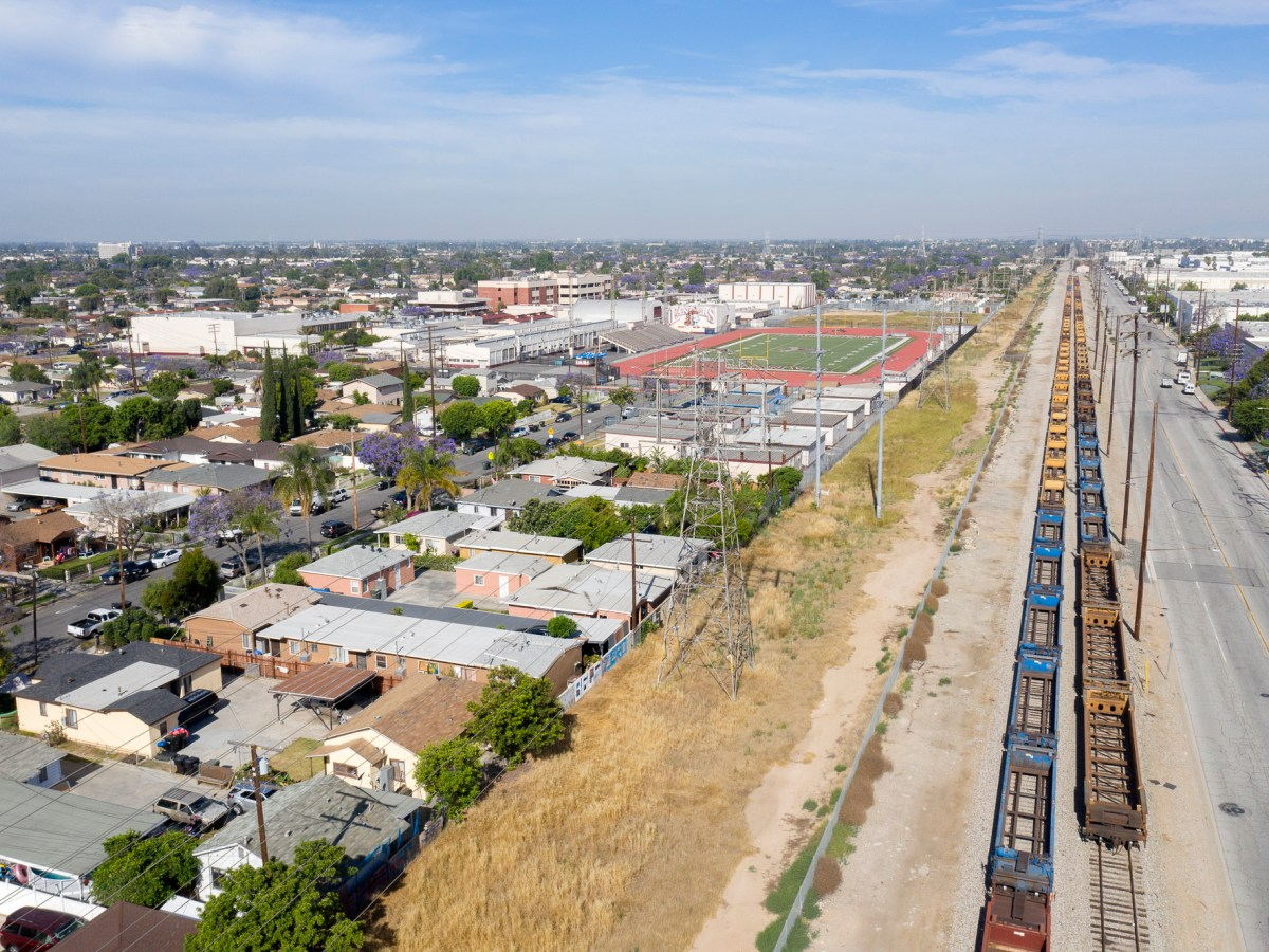 Arial view of a residential neighborhood near train tracks in Bell Gardens, East LA County. Photo by J. Emilio Flores, courtesy of Cal State LA