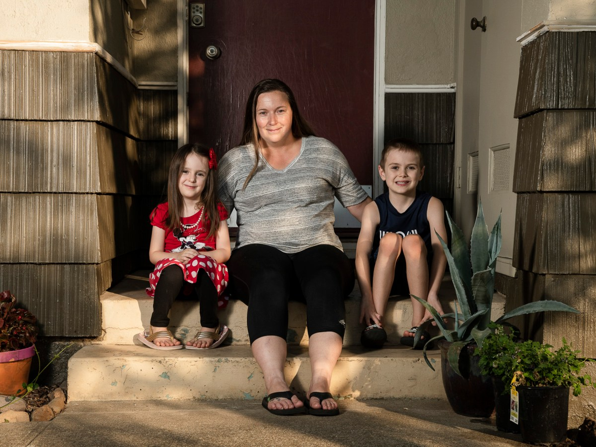 Kyla Hill, 5, left, Becky Hill, center, and Kaden Hill, 7, right, sit for a portrait at their home in Chico on July 23, 2020. Photo by Salgu Wissmath for CalMatters