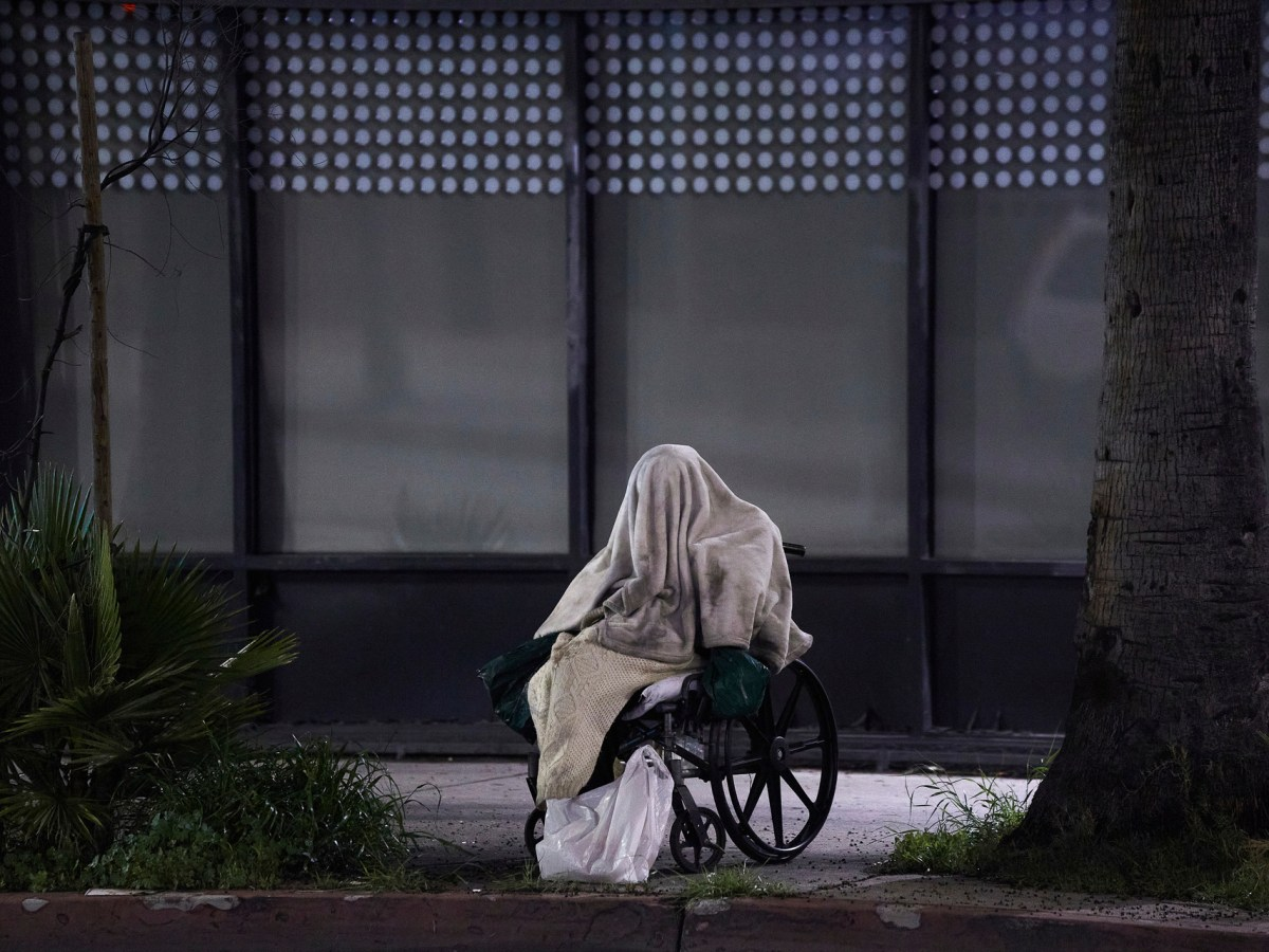 A homeless person in a wheelchair on Sunset Boulevard in Los Angeles. The has struggled with how to provide care for people with mental illness, but a new state audit says the solution isn't lowering the criteria for compelling mentally ill Californians to get treatment. Photo by Damian Dovarganes, AP Photo