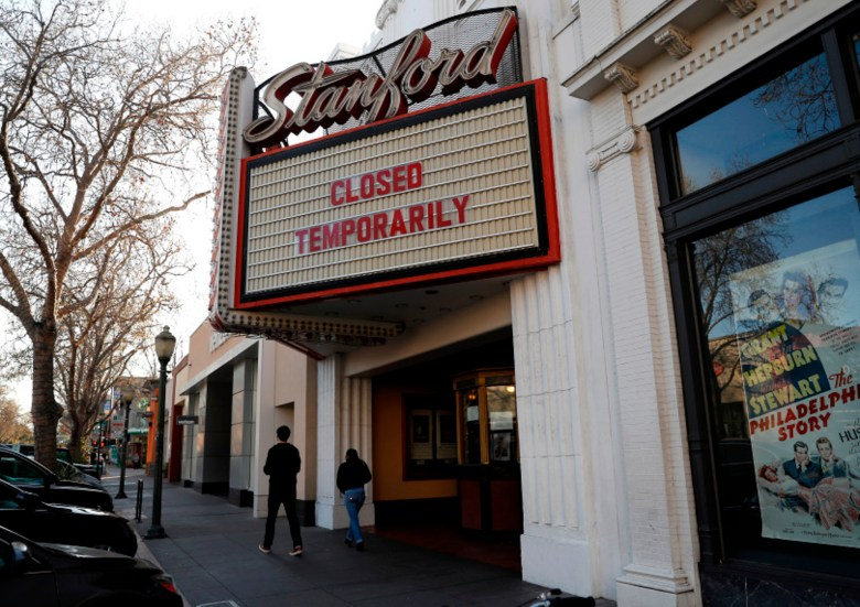 A sign outside of the Stanford Theatre announcing its temporary closure in downtown Palo Alto on March 4, 2020. Photo by Nhat V. Meyer, Bay Area News Group