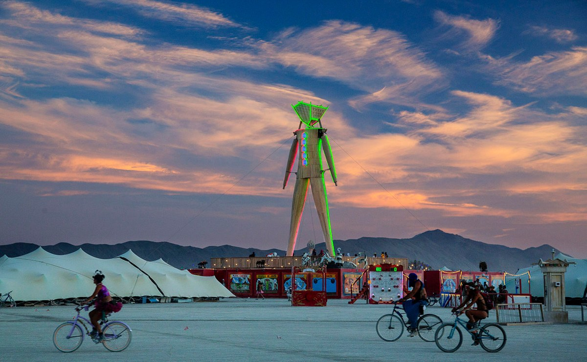 Festival attendees bike through the desert at Burning Man. Photo by BLM Nevada via Creative Commons