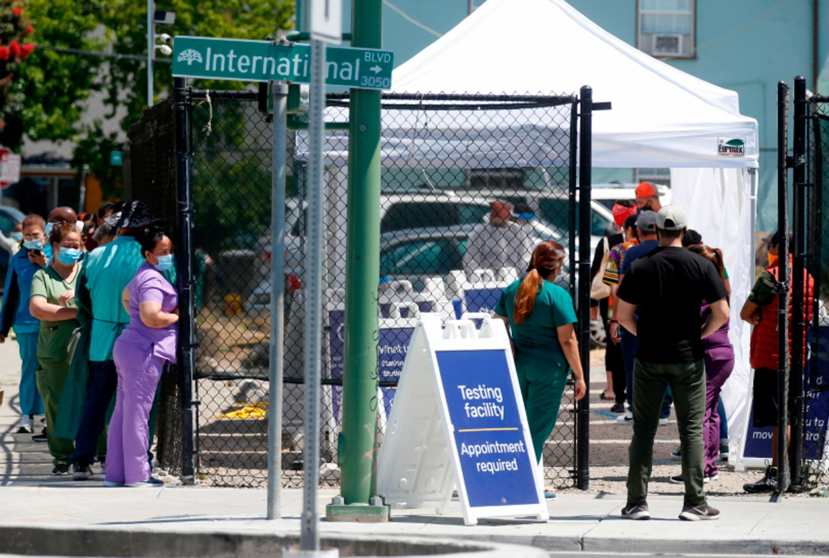 People wait in line at a Covid-19 testing facility sponsored by the Native American Health Center on International Boulevard near 31st Avenue in Oakland on July 7, 2020. Photo by Jane Tyska, Bay Area News Group