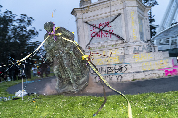 The statue of Francis Scott Key hits the ground after a group of more than one hundred protestors used ropes to pull it down in Golden Gate Park in San Francisco on June 19, 2020. Photo by Jungho Kim (CM use only)