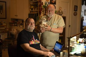 SAN FRANCISCO, CA - JULY 13: Dan Makevich, of San Francisco, poses with his husband Timothy Gilmore, and their dog Cognac while in their apartment in San Francisco, on Monday, July 13, 2020. Makevich, a senior citizen, is enrolled in a program for digital literacy for low-income elders. Seniors are most affected by COVID-19 and through a program by Community Tech Network they are assisted with training, internet connection and a tablet. Photo: Jose Carlos Fajardo/Bay Area News Group