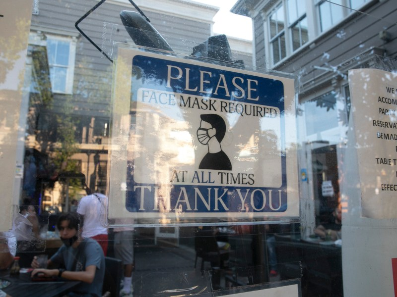 A sign requiring customers to wear a mask is posted outside of Modern China Cafe in Walnut Creek on August 16, 2020. Photo by Anne Wernikoff for CalMatters